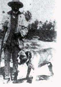 Um massaro acompanhado de seu cão (Puglia, década de 20)